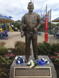 The life-size statue depicts Moore as the true hero he was.