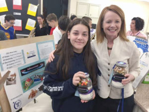 Mattlin Middle School principal Beth Torreano (right) joins student Stephanie Axelrod at the Gourmet Cookie Mix Sales Bazaar.