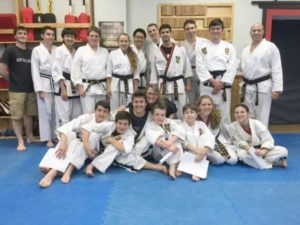 Messina and the Taecole black belt teen group. Most of these teens have been with Taecole since they were three years old.