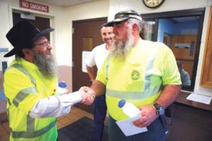 Rabbi Anchelle Perl (left) visited workers from the Town of Oyster Bay Sanitary Collection Services Division to express his gratitude for their hard work.
