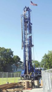 This drill rig was set up by the U.S. Navy to test for contamination in groundwater associated with the so-called Bethpage Plume. It is located at the corner of Red Maple Drive West and Wantagh Avenue in Wantagh. (Photo by Frank Rizzo)