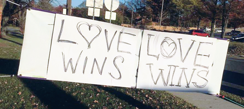 After a church's sign was defaced with racist rhetoric, church members came together to cover it up with a message of love.  (Photo by the Episcopal Diocese of Washington)