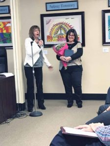 Nina Melzer thanks Janet Rutkowski for her service. (Photo by Victoria Onorato)
